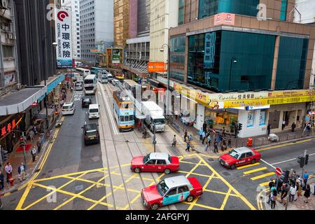 Traffic on Des Voeux Road Central. Central, Hong Kong, China. - Stock Photo