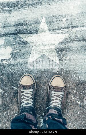 Standing on the road with star shape imprint - talent, vip, prize and award concept