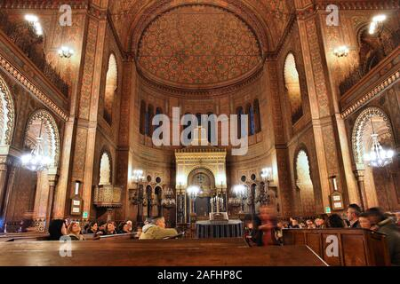 FLORENCE, ITALY - MAY 1, 2015: People visit the Great Synagogue in Florence, Italy. The landmark is also known as Tempio Maggiore. - Stock Photo