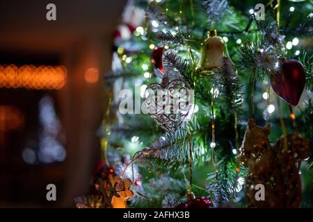Decorated Christmas tree on blurred background. Christmas concept. - Stock Photo