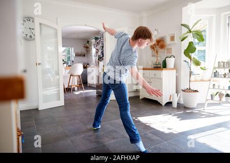 Young Downs Syndrome Man Having Fun Dancing At Home - Stock Photo