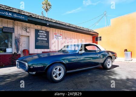 Classic car Pontiac Firebird on the premises of a used car dealer, Santa Cruz, California, USA - Stock Photo