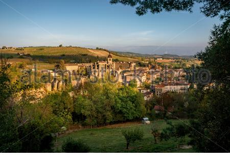 Saint-Antoine-l'Abbaye in late afternoon sun - Stock Photo