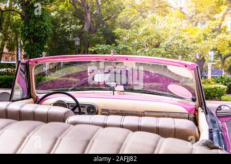 Pink old american classic car in Havana, Cuba - Stock Photo