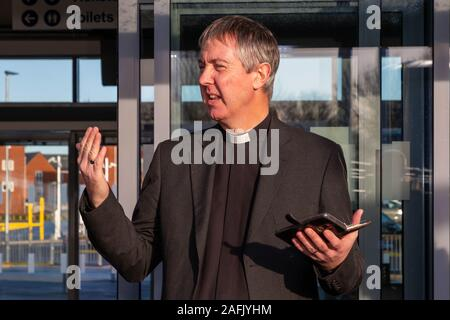 Warrington, Cheshire, UK. 16th Dec, 2019. The Reverend Martin Thorpe gives a prayer at the beginning of the official opening of Warrington West Railway Station on 16 December 2019 Credit: John Hopkins/Alamy Live News - Stock Photo