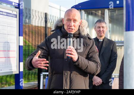 Warrington, Cheshire, UK. 16th Dec, 2019. Chris Jackson, Northern Rail's Regional Director for the West, addresses the guests at the official opening of Warrington West Railway Station on 16 December 2019 Credit: John Hopkins/Alamy Live News - Stock Photo