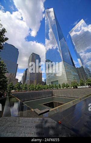 9/11 - 0911 - National September 11 Memorial North Tower Fountain,with One World Trade Center,Lower Manhattan,New York City, NY, USA - Stock Photo