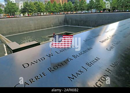 9/11 - 0911 - National September 11 Memorial North Tower Fountain with USA flag,One World Trade Center,Lower Manhattan,New York City, NY, USA - Stock Photo