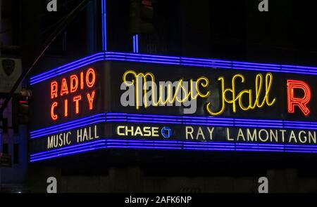 Radio City Music Hall facade New York, 1260 Avenue of the Americas (Sixth Avenue), Manhattan, New York City, NY, USA at night, neon lights - Stock Photo