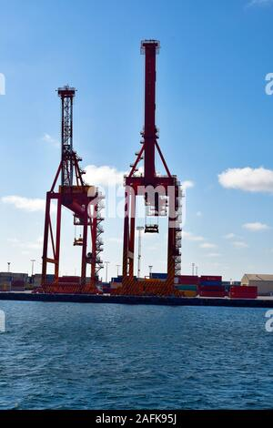 Perth, WA, Australia - November 27, 2017: Cranes and container on shipping terminal in Fremantle on Swan River - Stock Photo