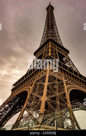 Beautiful view of the Eiffel tower during Winter period. Heavy sky over Eiffel tower, the symbol of Paris, France - Stock Photo