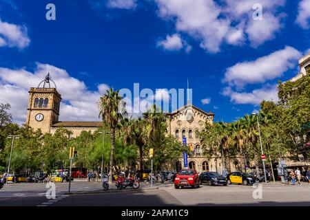 BARCELONA, SPAIN - OCTOBER 8, 2019: Unidentified people by University of Barcelona building in Spain. This historic building was built between 1863-18 - Stock Photo