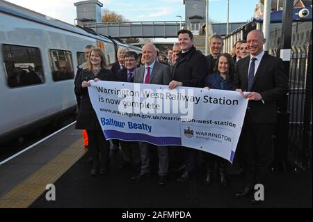Warrington, Cheshire, UK. 16th Dec, 2019. Council leaders, railway staff and local dignitaries attend the official opening of Warrington West railway station. The £20.5 million station project has been funded by Warrington Borough Council, the Department for Transport, developer contributions and Cheshire and Warrington Local Enterprise Partnership. The station is managed by Northern Trains and will provide vital links for the Chapelford community to Liverpool and Manchester, with 4 trains per hour, a 250 car capacity park and ride and local bus services. Credit: G.P.Essex/Alamy Live News - Stock Photo