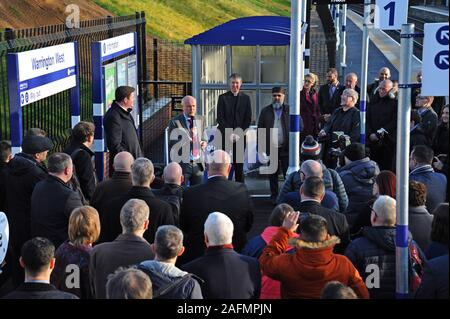 Warrington, Cheshire, UK. 16th Dec, 2019. Council leaders, railway staff and local dignitaries attend the official opening of Warrington West railway station as Council leader Cllr Russ Bowden addresses the crowd. The £20.5 million station project has been funded by Warrington Borough Council, the Department for Transport, developer contributions and Cheshire and Warrington Local Enterprise Partnership. Credit: G.P.Essex/Alamy Live News - Stock Photo