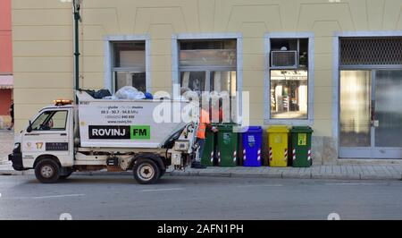 Waste and recycling collection lorry in Revinj, Croatia - Stock Photo