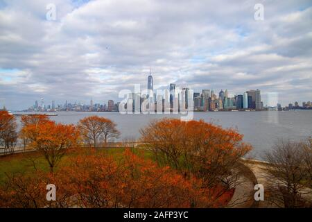 View of New York city skyline with the autumn trees from Ellis Island in USA, October 15,2018 - Stock Photo