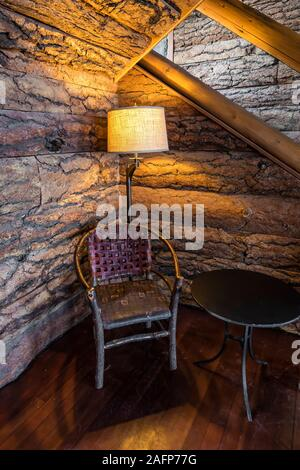 Bark-textured rustic interior of historic Crater Lake Lodge in Crater Lake National Park in Oregon, USA - Stock Photo
