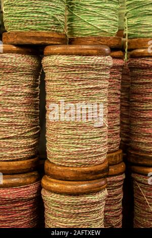 close up detail of reels of cotton yarn in Sir Richard Arkwright's cotton and textile mill at Masson Mills Museum Derbyshire UK - Stock Photo