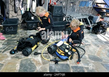 Children preparing diving equipment for discover scuba diving,  Zakynthos island, Greece - Stock Photo