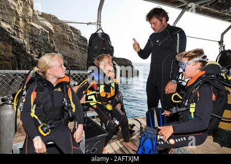 Scuba instructor briefing children before discover scuba diving, Zakynthos island, Greece - Stock Photo
