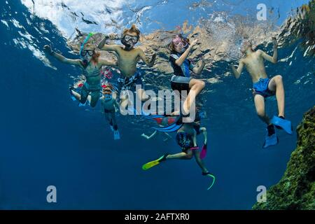 Adult snorkelling with a group children in Mediterranean sea, Zakynthos island, Greece - Stock Photo