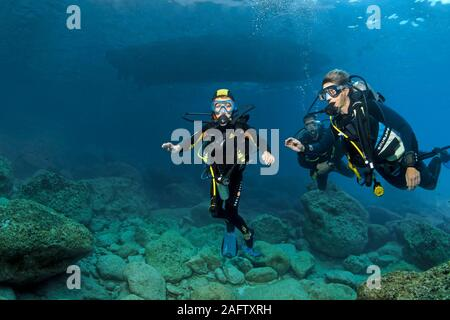 Scuba instructor with children, intro diving, Zakynthos island, Greece - Stock Photo