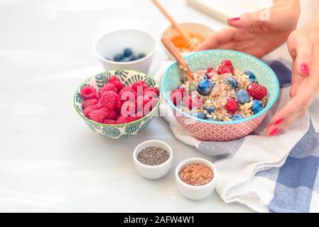 breakfast buckwheat porridge with raspberries and blueberries, good morning concept - Stock Photo