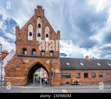 the 1450 brick Wassertor(water gate) is the only remaining original city gate to the Hanseatic City of Wismar, Mecklenburg-Vorpommern, Germany - Stock Photo