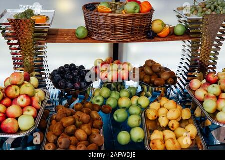 plates with fresh fruit oranges apples pineapple bananas healthy - Stock Photo