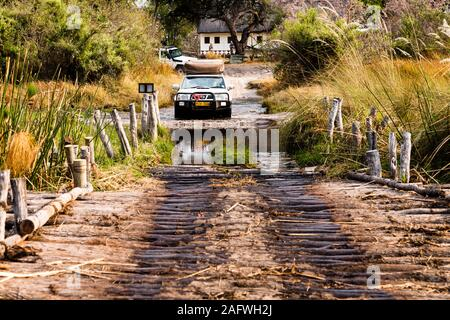 4x4 crossing river at 3rd bridge, Moremi game reserve, Okavango delta, Botswana, Africa - Stock Photo