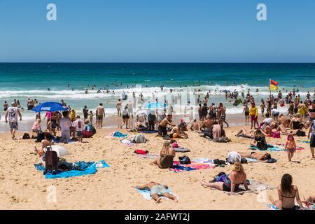 People sunbathing on Manly beach, Sydney, Australia - Stock Photo