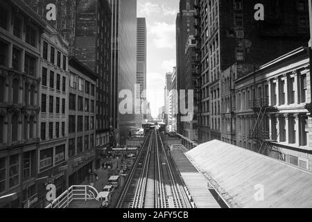 Chicago, Illinois, USA - 1996:  Archival black and white view of downtown architecture and elevated rail tracks along Wasbash Ave. - Stock Photo