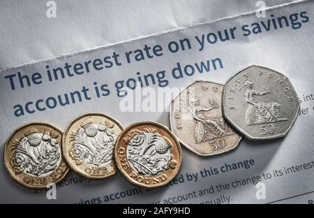A Bank letter advising the customer the interest rates are going down on their savings account - Stock Photo