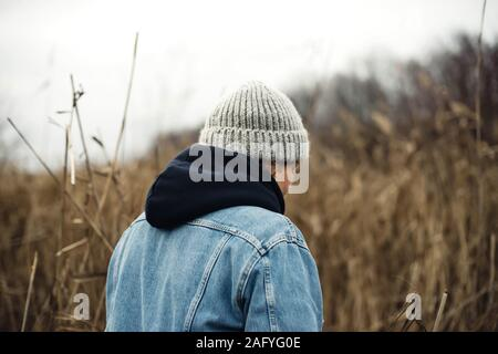 Portrait of a 40 years old woman in a hat outdoors - Stock Photo