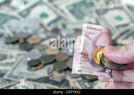 Turkish lira TRY coins and banknotes against background of american dollar USD banknotes and some russian ruble RUB coins - Stock Photo