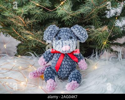 Plush toy, Christmas tree and Christmas decorations - Stock Photo