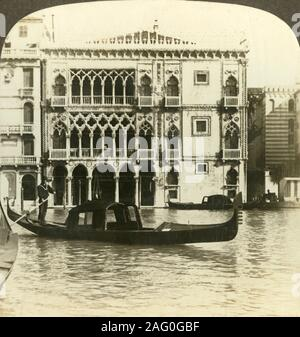 'Palazzo Ca' d'Oro, home of an old merchant of Venice, (N.E.), Italy', c1909. The Ca' d'Oro or Palazzo Santa Sofia palace on the Grand Canal in Venice was built between 1428 and 1430 in Venetian Gothic style by Giovanni Bon and his son Bartolomeo Bon, it now houses the Galleria Giorgio Franchetti art museum. To be viewed on a Sun Sculpture stereoscope made by Underwood & Underwood. [The Rose Stereograph Company, Melbourne, Sydney, Wellington & London, c1909] - Stock Photo