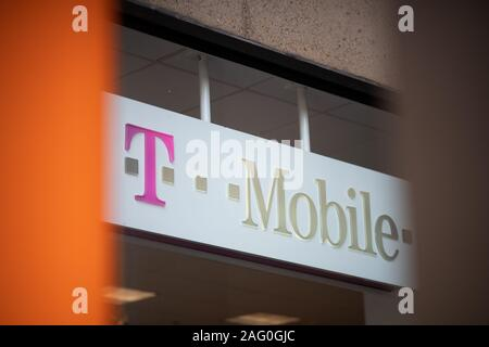 A T-Mobile logo on a storefront in Washington, D.C., as seen on August 14, 2019. (Graeme Sloan/Sipa USA) - Stock Photo