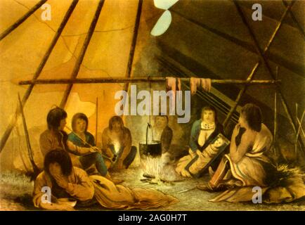 """'Interior of a Cree Indian Tent', 1820, (1946). Indigenous people round a fire in northern Canada, depicted by a member of John Franklin's Coppermine Expedition of 1819-1822. Meat is being smoked over the cooking fire. Illustration from """"Narrative of a Journey to the Shores of the Polar Sea"""" by Franklin. Published in """"British Polar Explorers"""", by Admiral Sir Edward Evans. [Collins, London, 1946] - Stock Photo"""
