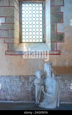 Follina, Italy - July 20,2019:  A statue of the Madonna with Child in the old refectory of the Cistercian Abbey of Santa Maria - Stock Photo