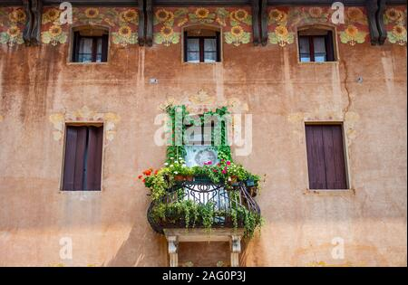 Cison di Valmarino, Italy - July 20,2019: An old house with flowered balcony - Stock Photo
