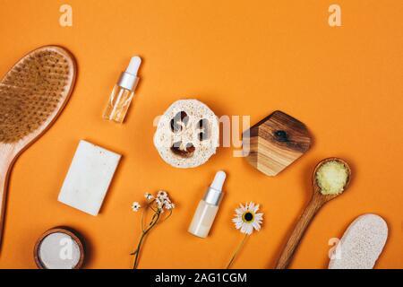 Natural zero waste cosmetics on orange background. Flat lay style - Stock Photo