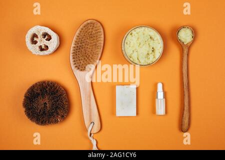 Natural zero waste cosmetics on orange background. Flat lay style - Stock Photo