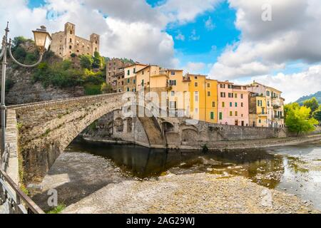 The colorful hilltop, medieval village of Dolceacqua, Italy, with it's famous castle and stone Monet bridge. - Stock Photo