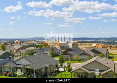 New construction homes being built in a subdivision hilltop overlooking a valley in an area of new homes in the Spokane, Washington area of the U.S. - Stock Photo