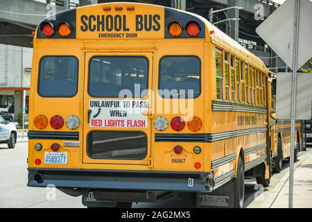 SEATTLE, WASHINGTON STATE, USA - JUNE 2018: Yellow school bus parked on a street in downtown Seattle. - Stock Photo