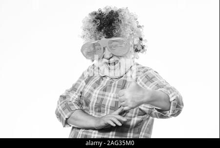 Elderly clown. Having fun. Funny lifestyle. Fun and entertainment. Comic grandfather concept. Nice joke. Grandpa always fun. Man senior bearded cheerful person wear colorful wig and sunglasses. - Stock Photo