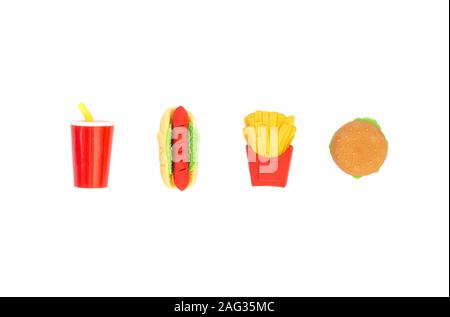 Background of varied toy fast food in miniature isolated on a white background. - Stock Photo