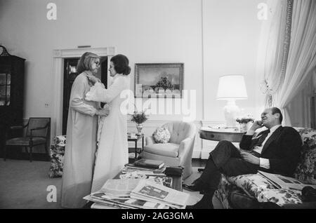 First Lady Betty Ford and Daughter Susan wearing Bathrobes and interacting Affectionately as U.S. President Gerald Ford looks on, Living Quarters of White House, Washington, D.C., USA, photograph by Marion S. Trikosko, February 1975