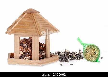 Bird seed in a bird box with a fat ball - Stock Photo